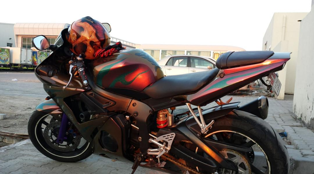 This is a side view of the chameleon super bike painted with our Gold Orange Red Chameleon. 4739OR.