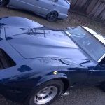 Electric Blue Corvette painted over black base coat. True kustom Paint.