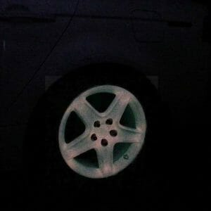 Glow in the Dark Wheel painted with our Pink to Orange Glow in the Dark kustom paint Pigment.