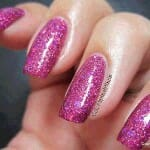 Nails painted with Holographic Flake kustom mixed together.