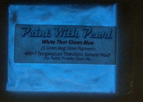 """White that Glows Blue paint pigment. Glows at night after being """"charged"""" under light."""